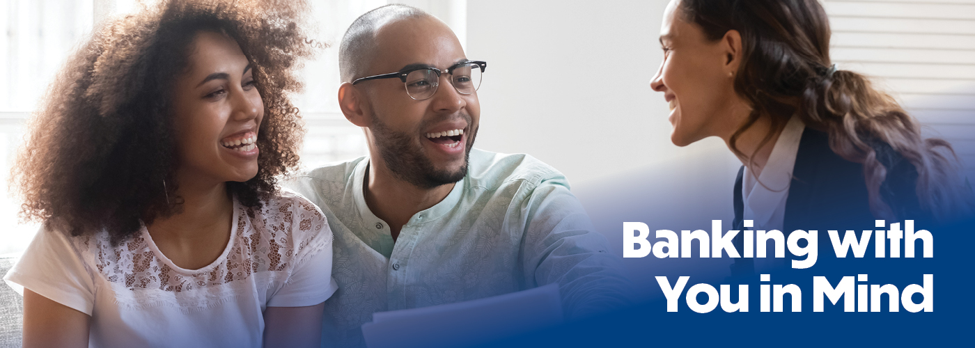 african american couple speaking with realtor, the text overlaying the image reads banking with you in mind.