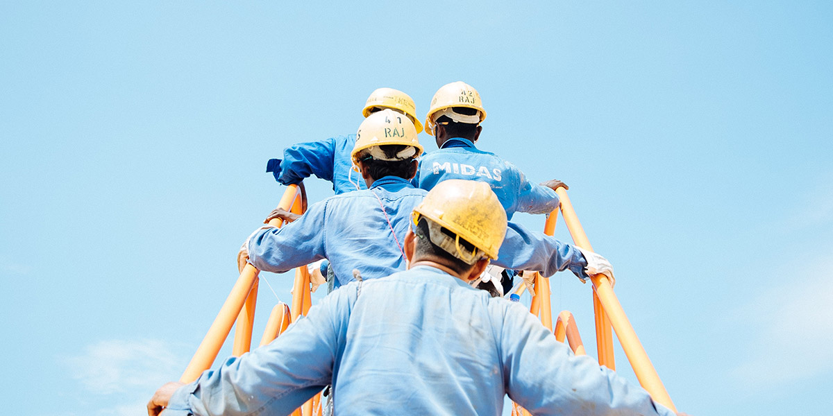 men in hard hats climbing outdoor staircase