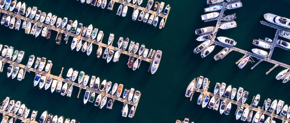 aerial view of a bay with boats tied to docks